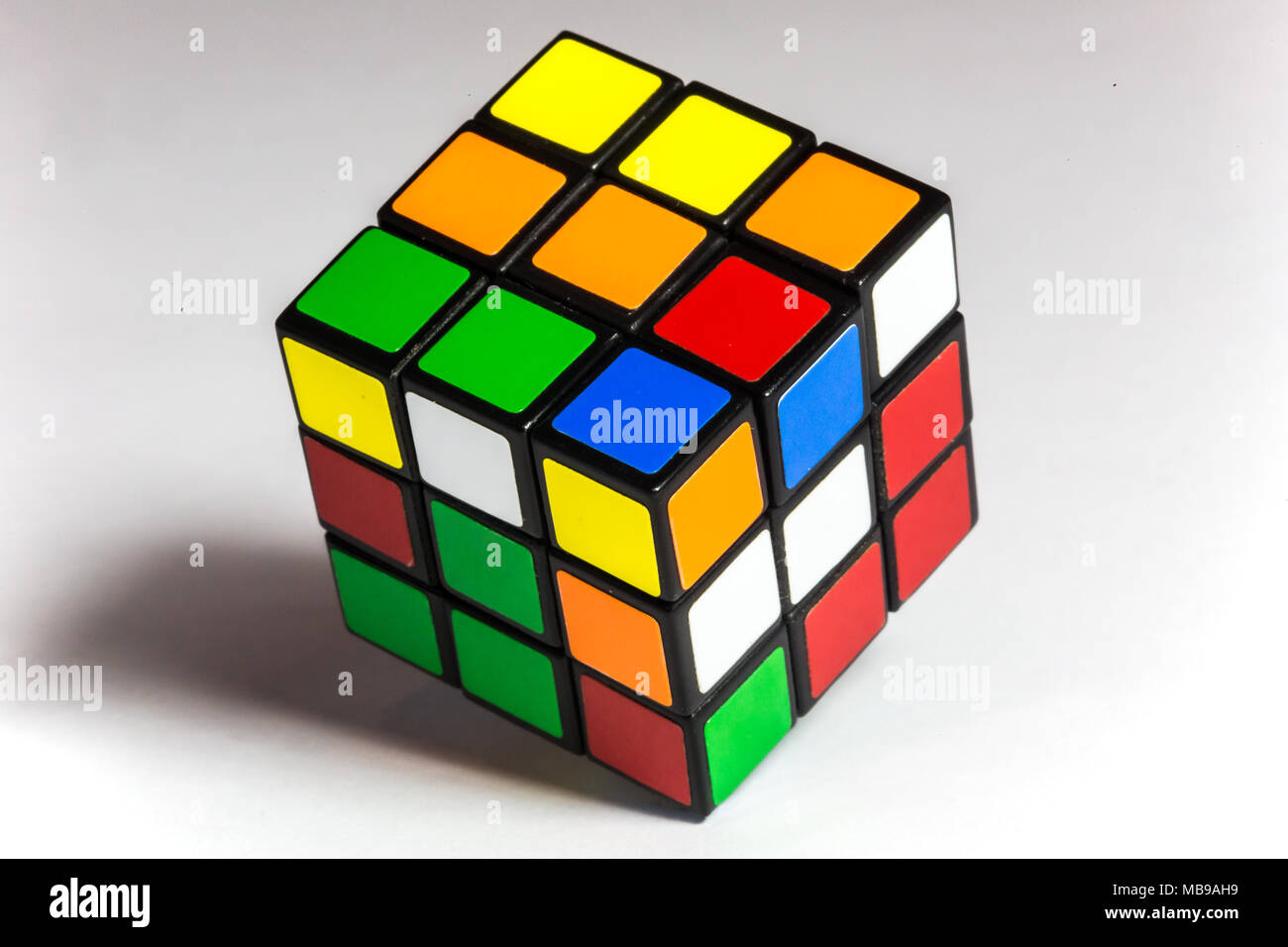 A Rubik's Cube (originally a Magic Cube) is a 3-D combination puzzle invented in 1974 by Hungarian sculptor and professor of architecture Ernő Rubik. - Stock Image