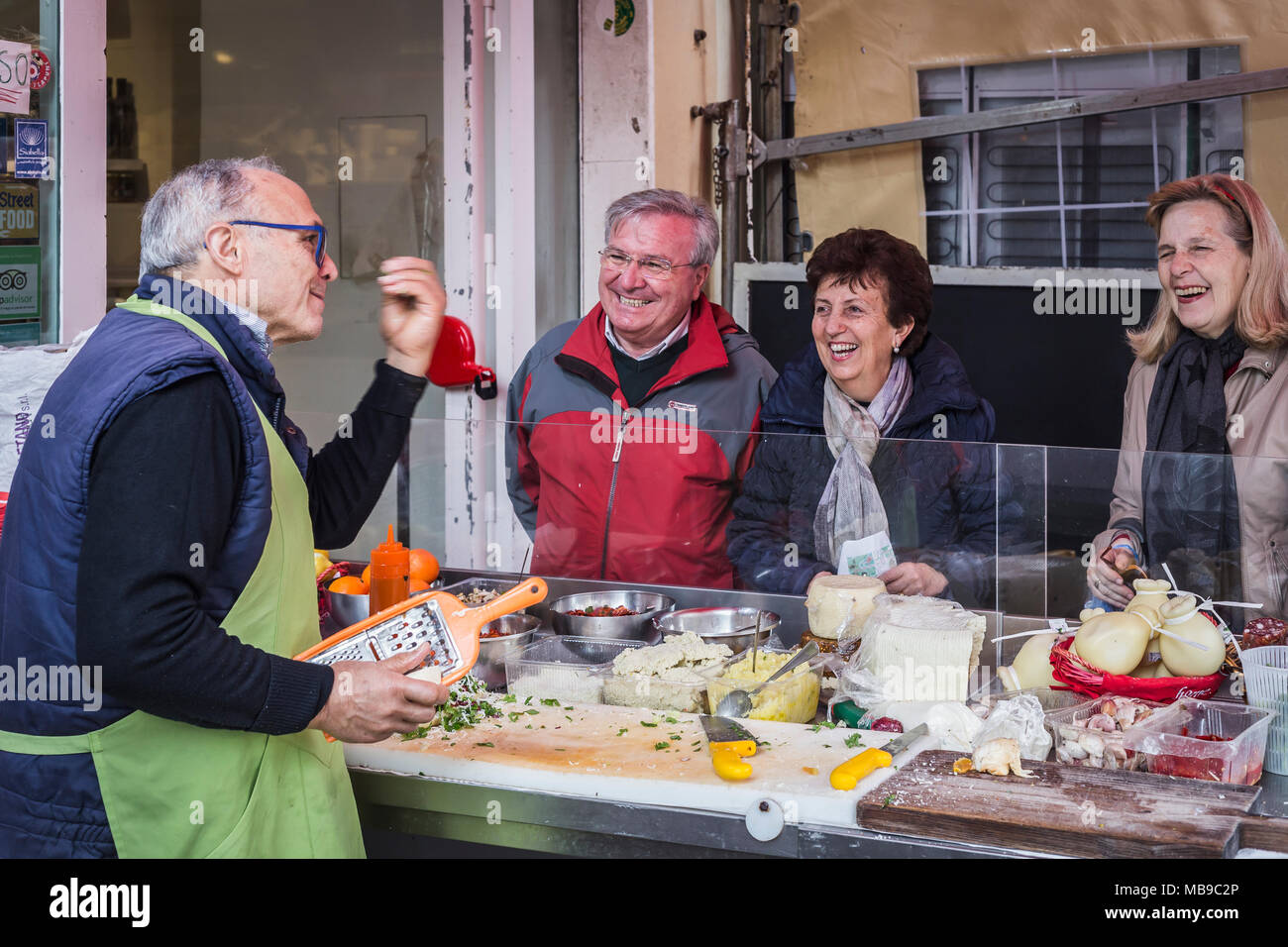 Seller of sandwiches with local products to the market of Ortigia, Siracusa, Sicily, Italy. - Stock Image
