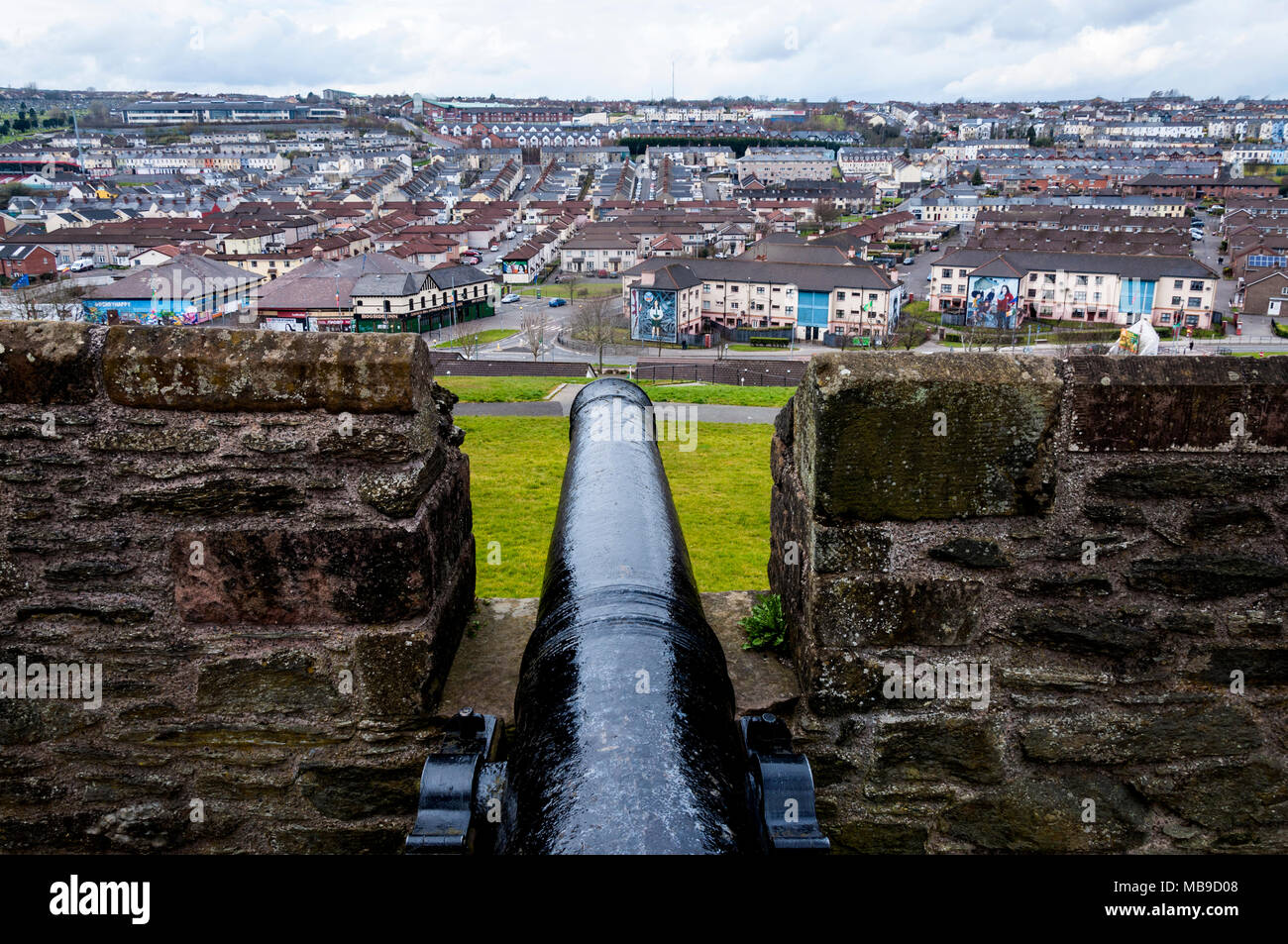 The Bogside area Londonderry, Derry, City of Derry, Northern Ireland, UK. From City walls with old cannon barrel. - Stock Image