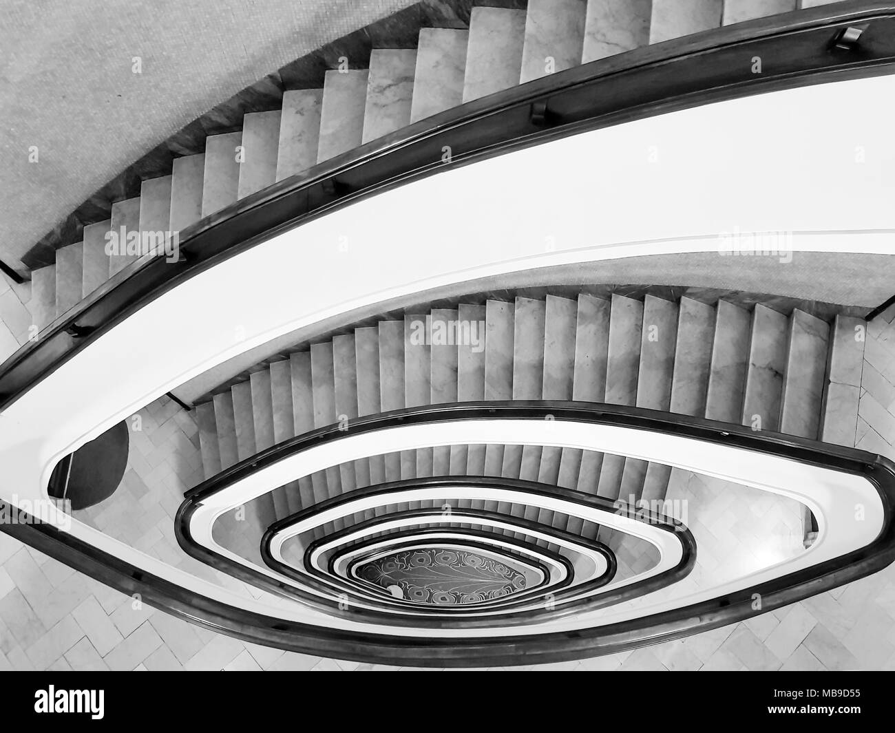 Black And White View To The Beautiful Spiral Staircase In Building , Spiral Circle  Staircase Decoration Interior Background.