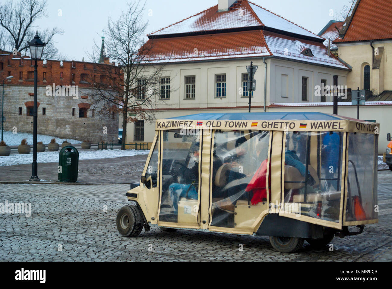 Golf cart, tourist transport, in front of Wavel fortress hill, Krakow, Malopolska, Poland - Stock Image