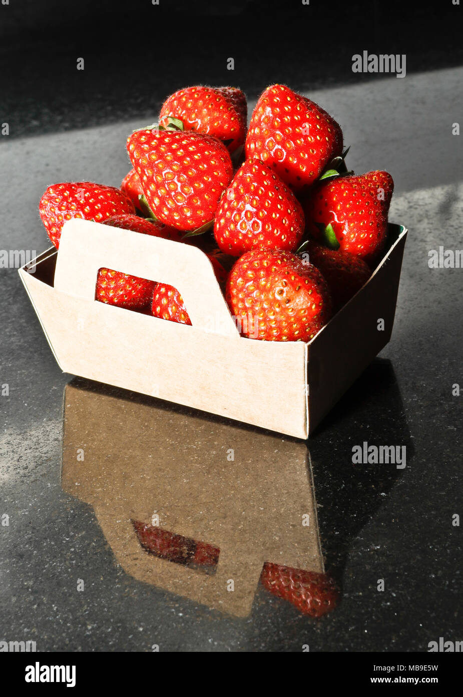 Strawberries in a box - Stock Image