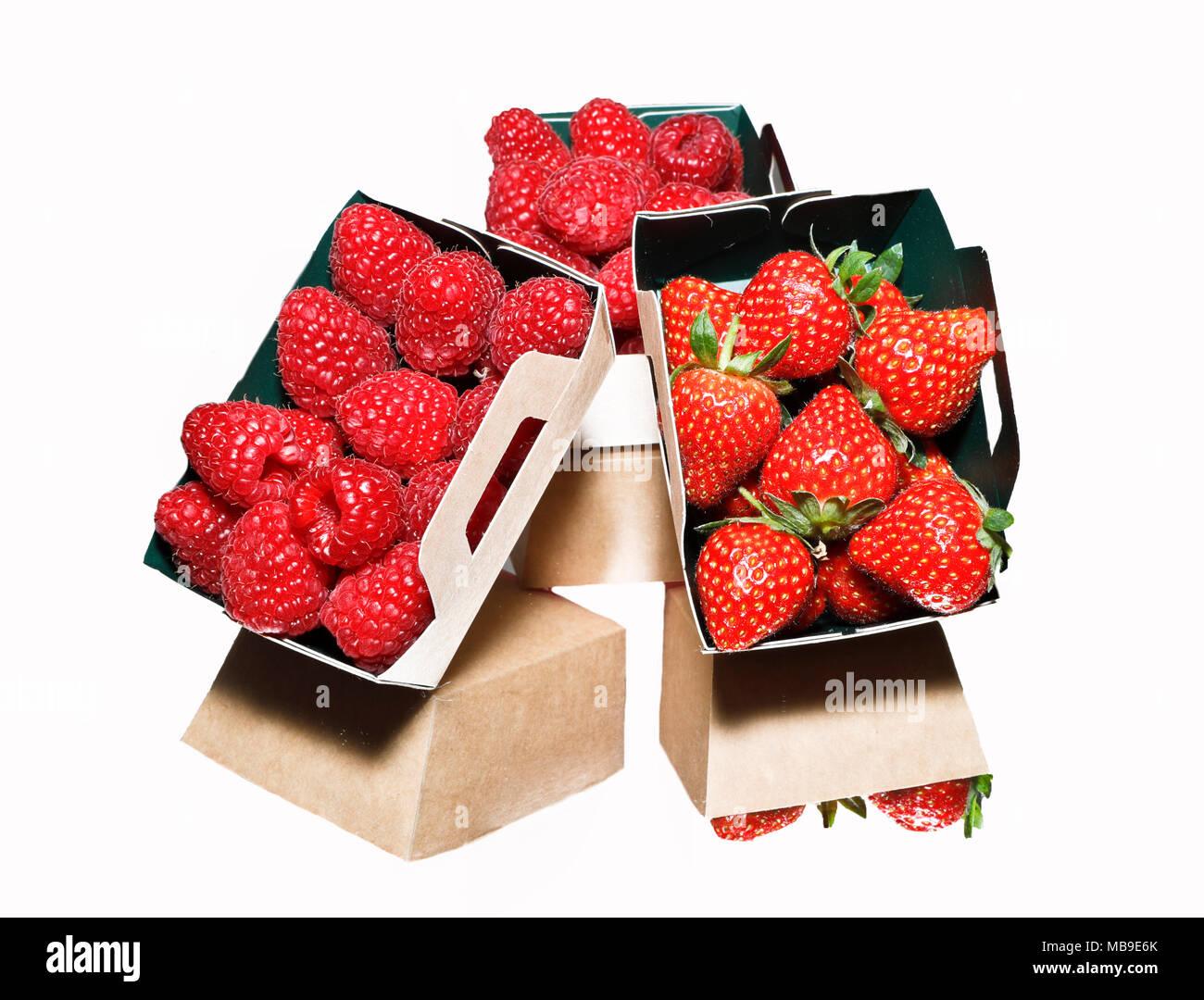 Fresh strawberries and raspberries on white background - Stock Image