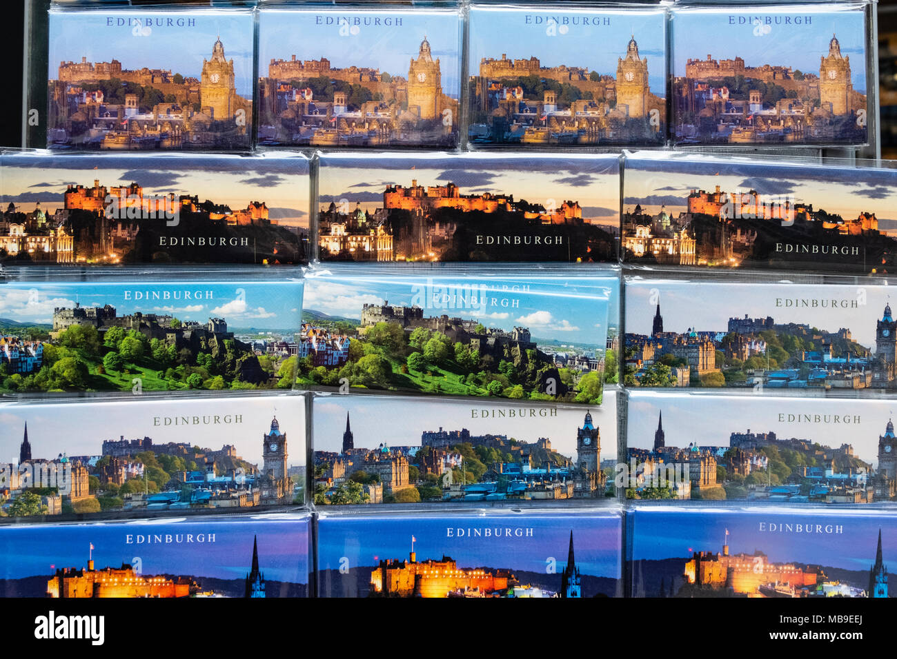 Detail of tourist fridge magnets with views of Edinburgh for sale in souvenir shop on Royal Mile in Edinburgh, Scotland, United Kingdom - Stock Image