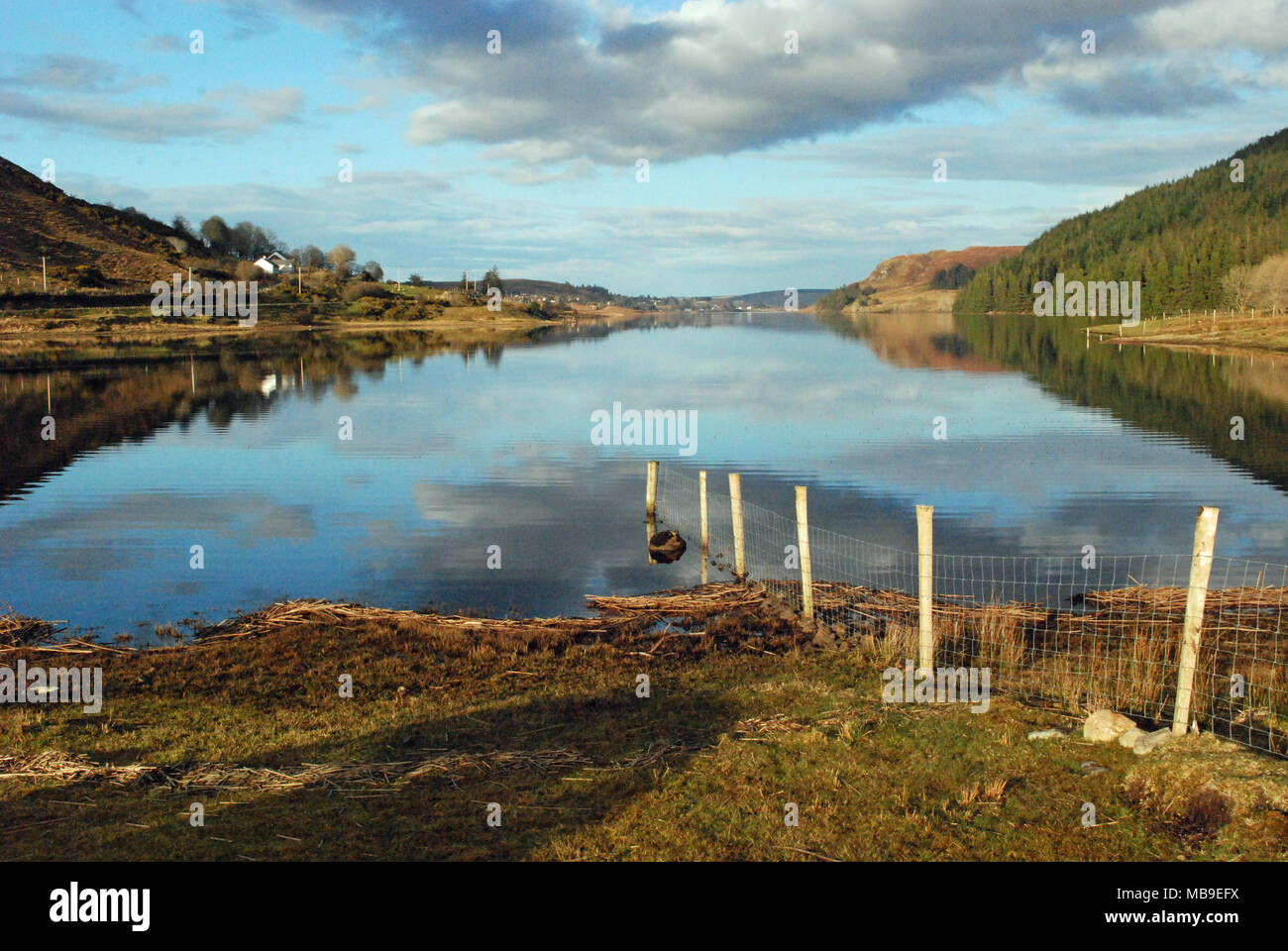 View of Lough Finn near Fintown in County Donegal, Ireland. Fintown railway runs along its lakeshore. - Stock Image