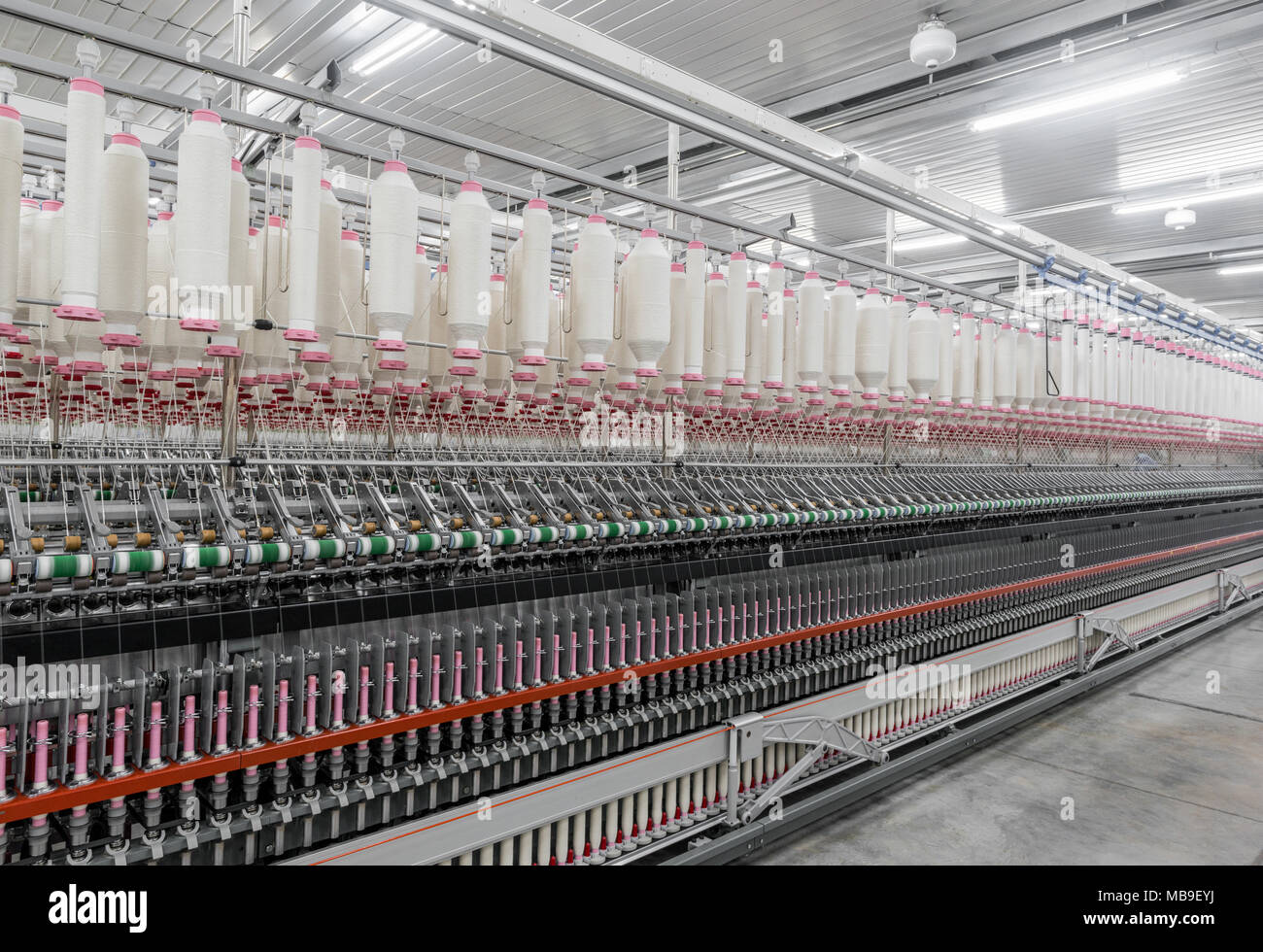 Machinery and equipment in the workshop for the production of thread. interior of industrial textile factory Stock Photo
