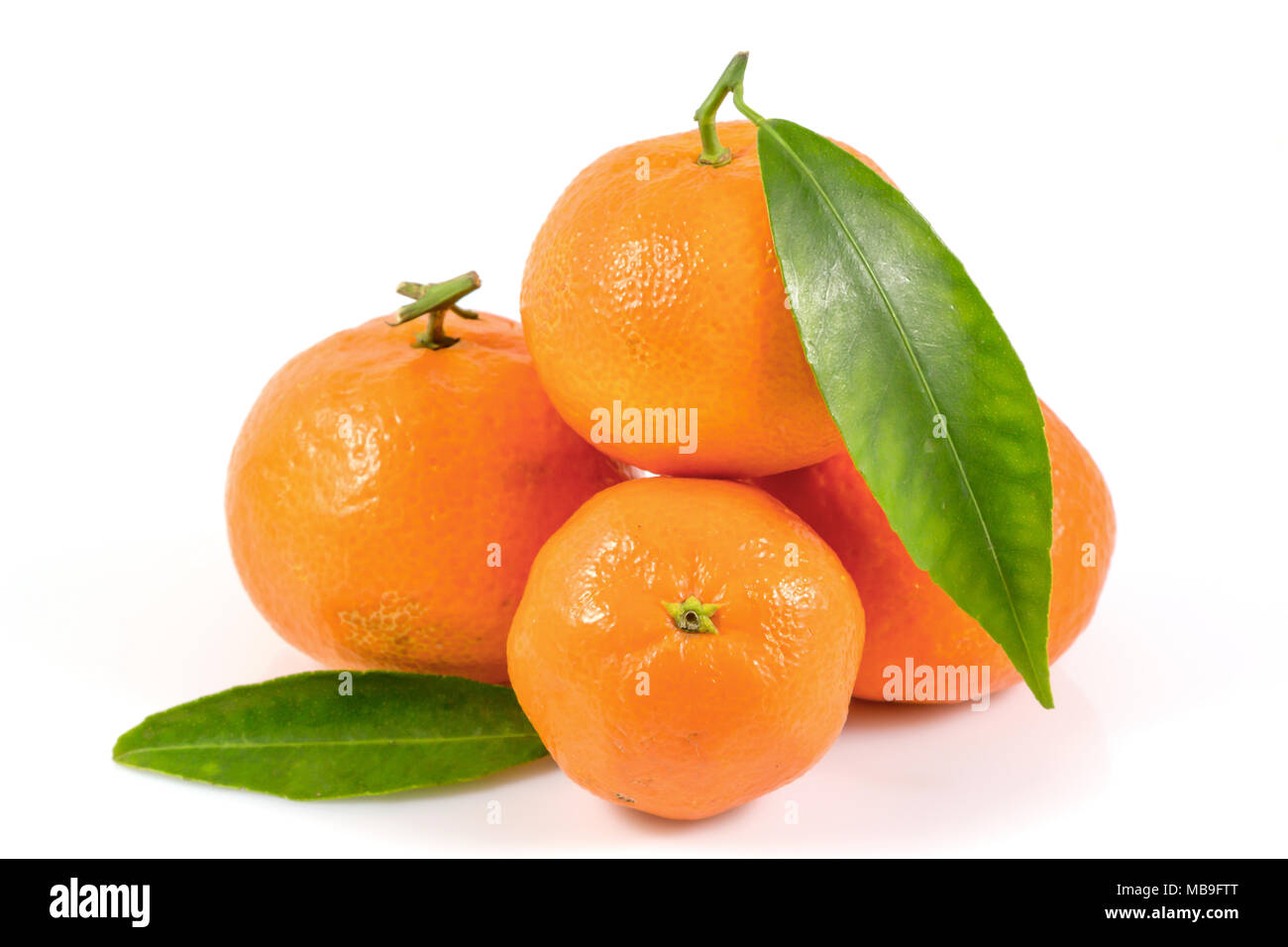 Fresh tangerines oranges with leaves isolated on white background, Healthy fruits, with a clipping path Top view. - Stock Image