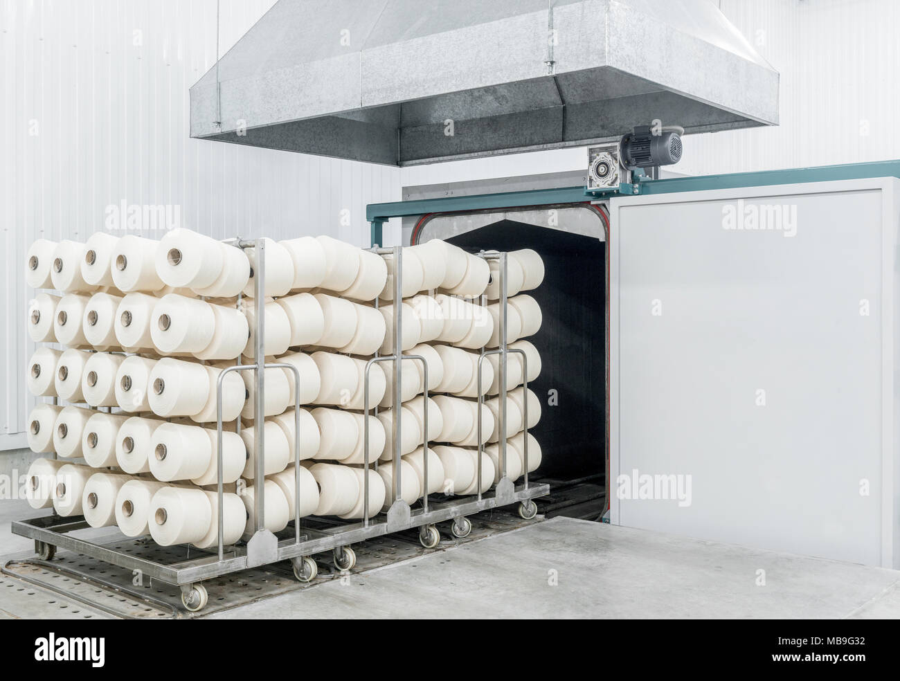 trolley with finished products in the drying room at the textile factory - Stock Image