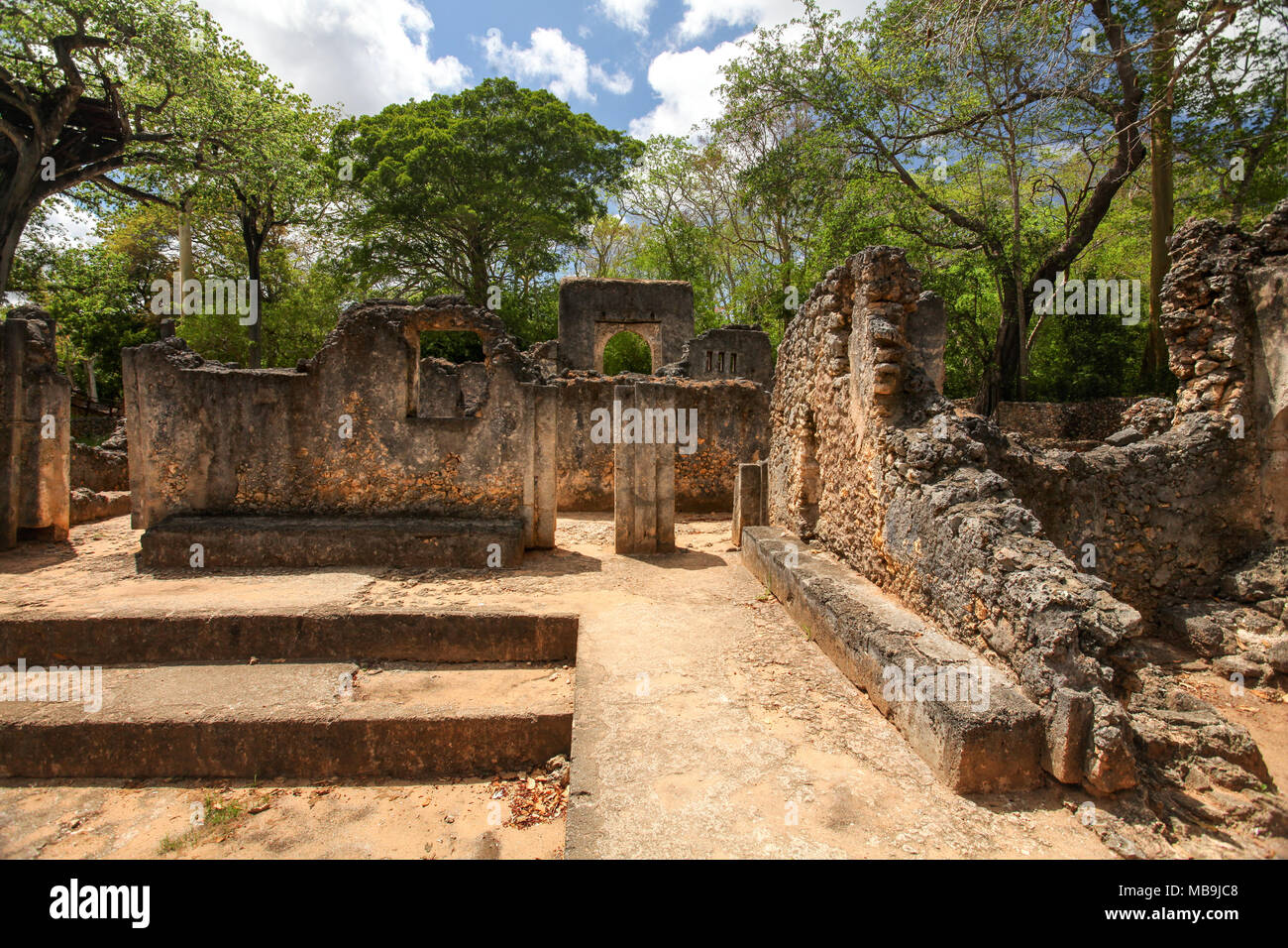 Remains of ancient african city Gede (Gedi) in Watamu, Kenya with trees and sky in background. - Stock Image