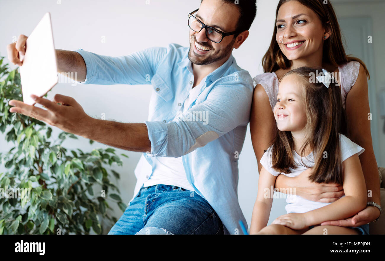 Happy family having fun time at home - Stock Image