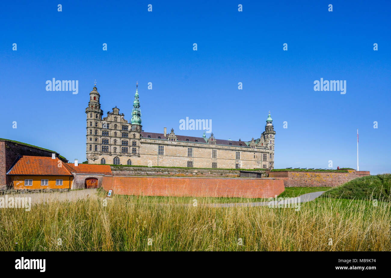 Kronborg Castle rises behind massiv defending walls, the magnificent Renaissance castle is immortalized as Elsinore in William Shakespeare's play Haml - Stock Image