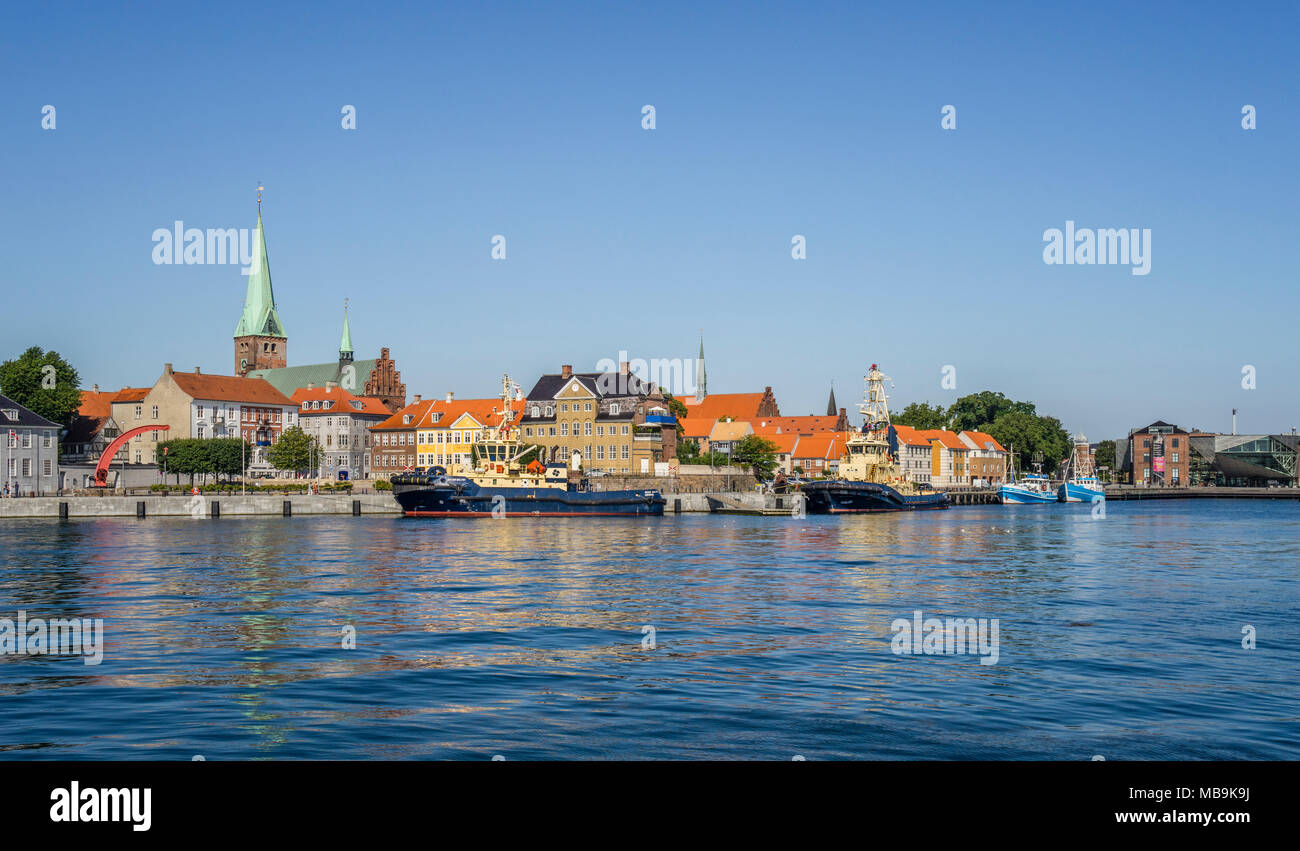 view of the Helsingor harbourfront with the tower of Saint Olaf's Church (left) and St. Mary's Church (right) rising over the town roofs, Helsingør, Z - Stock Image