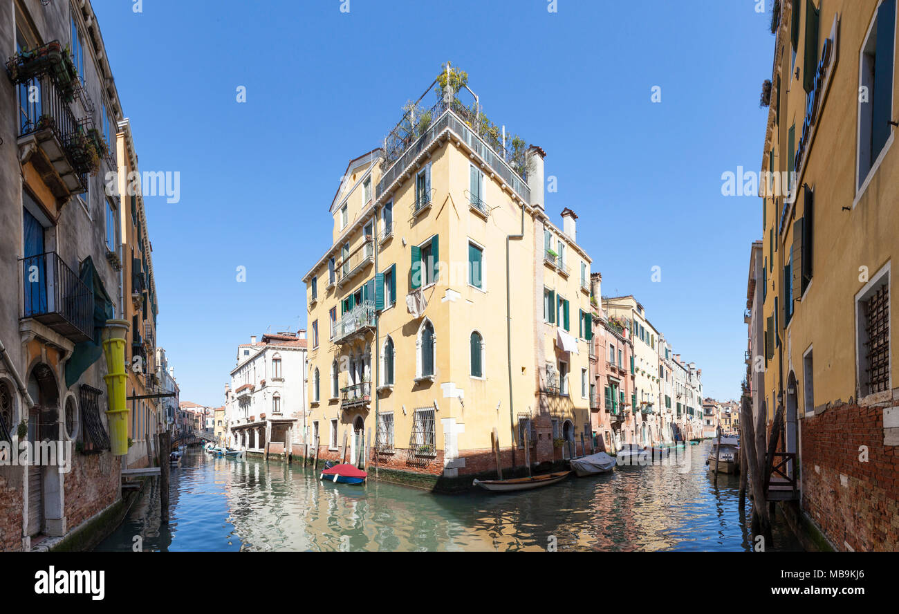 Stitched panorama of the confluence of Rio Priuli o de Santa Sofia and Rio Ca'Dolce, Canneragio, Venice, Veneto,  Italy with reflections on the water  - Stock Image