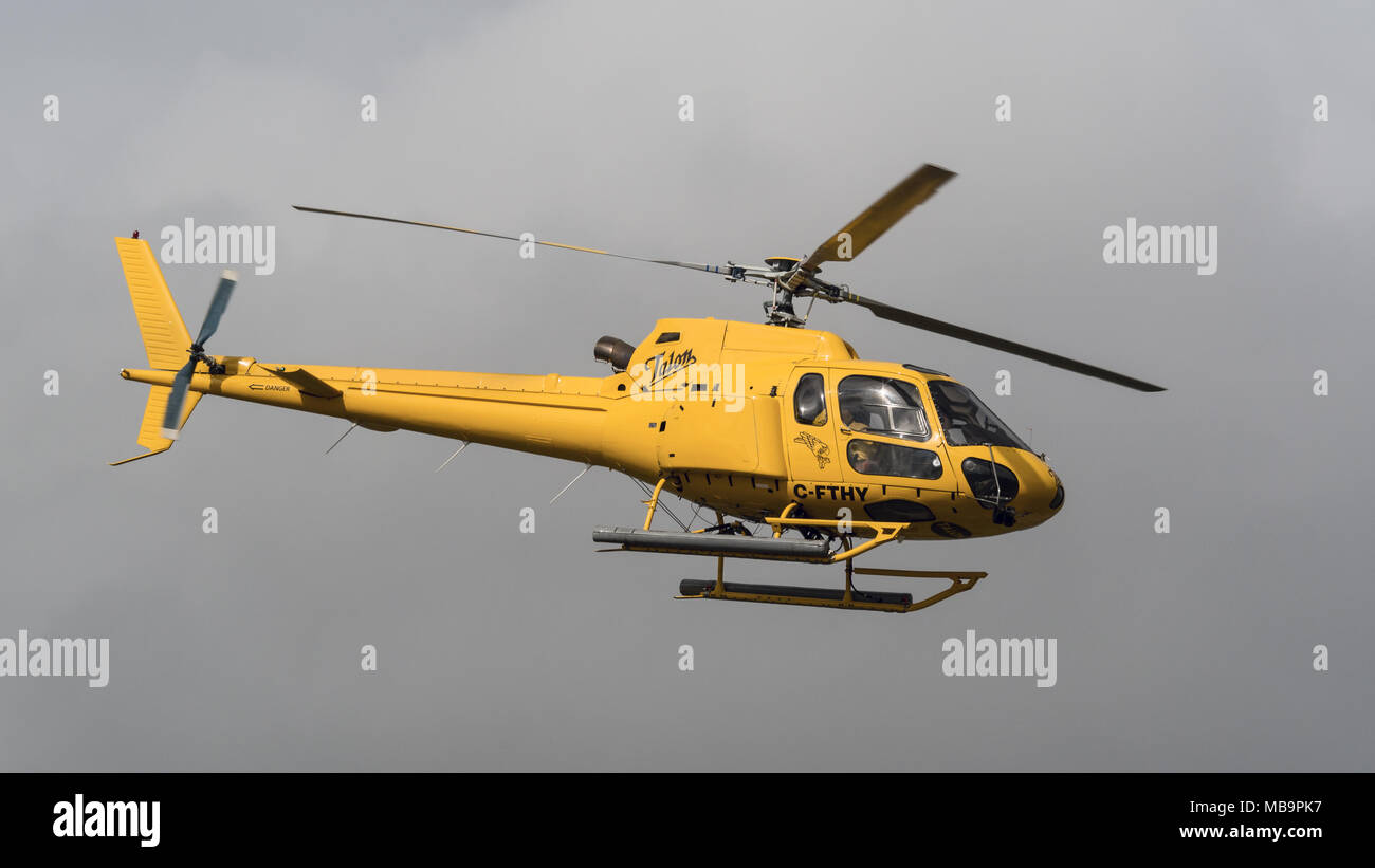 Richmond, British Columbia, Canada. 18th Mar, 2018. An Aerospatiale AS 350B2 Ecureuil helicopter (C-FTHY) belonging to Talon Helicopters Ltd. departs from Vancouver International Airport. Credit: Bayne Stanley/ZUMA Wire/Alamy Live News Stock Photo