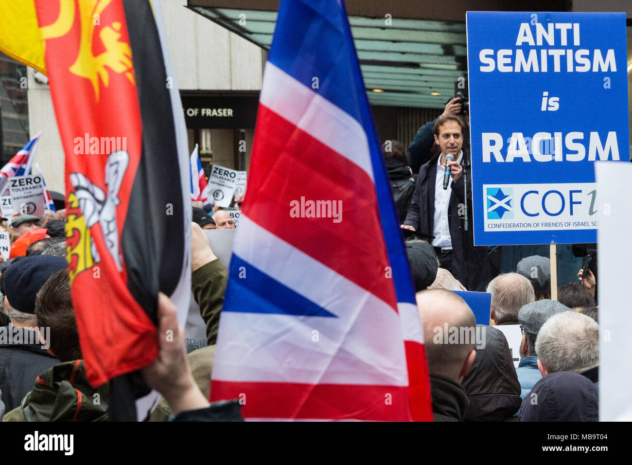 London, UK. 8th April, 2018. Gideon Falter, Chairman of the Campaign Against Antisemitism, addresses Jews and non-Jews attending a demonstration organised by the campaign outside the head office of the Labour Party to apply pressure on its leadership to demonstrate a 'zero tolerance' approach to anti-Semitism. Credit: Mark Kerrison/Alamy Live News - Stock Image