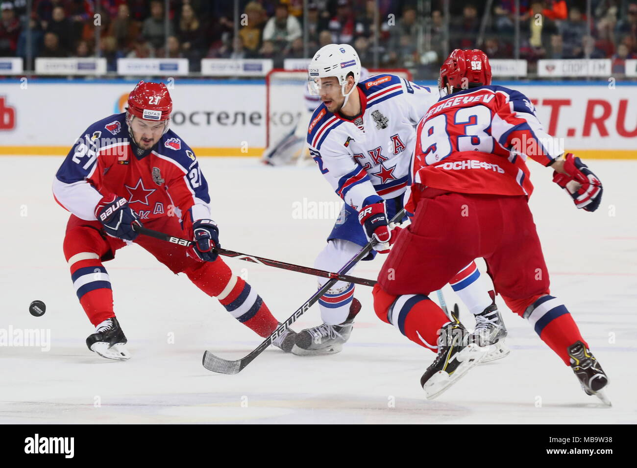 Moscow, Russia. 08th Apr, 2018. MOSCOW, RUSSIA - APRIL 8, 2018: CSKA Moscow's Kirill Petrov (L), Artyom Sergeyev (R) and SKA St Petersburg's Artyom Zub (C) in Game 6 of the 2017/2018 Kontinental Hockey League Western Conference final best-of-seven playoff between CSKA Moscow and SKA St Petersburg at CSKA Arena; CSKA Moscow won the game 3 - 2. Stanislav Krasilnikov/TASS Credit: ITAR-TASS News Agency/Alamy Live News - Stock Image