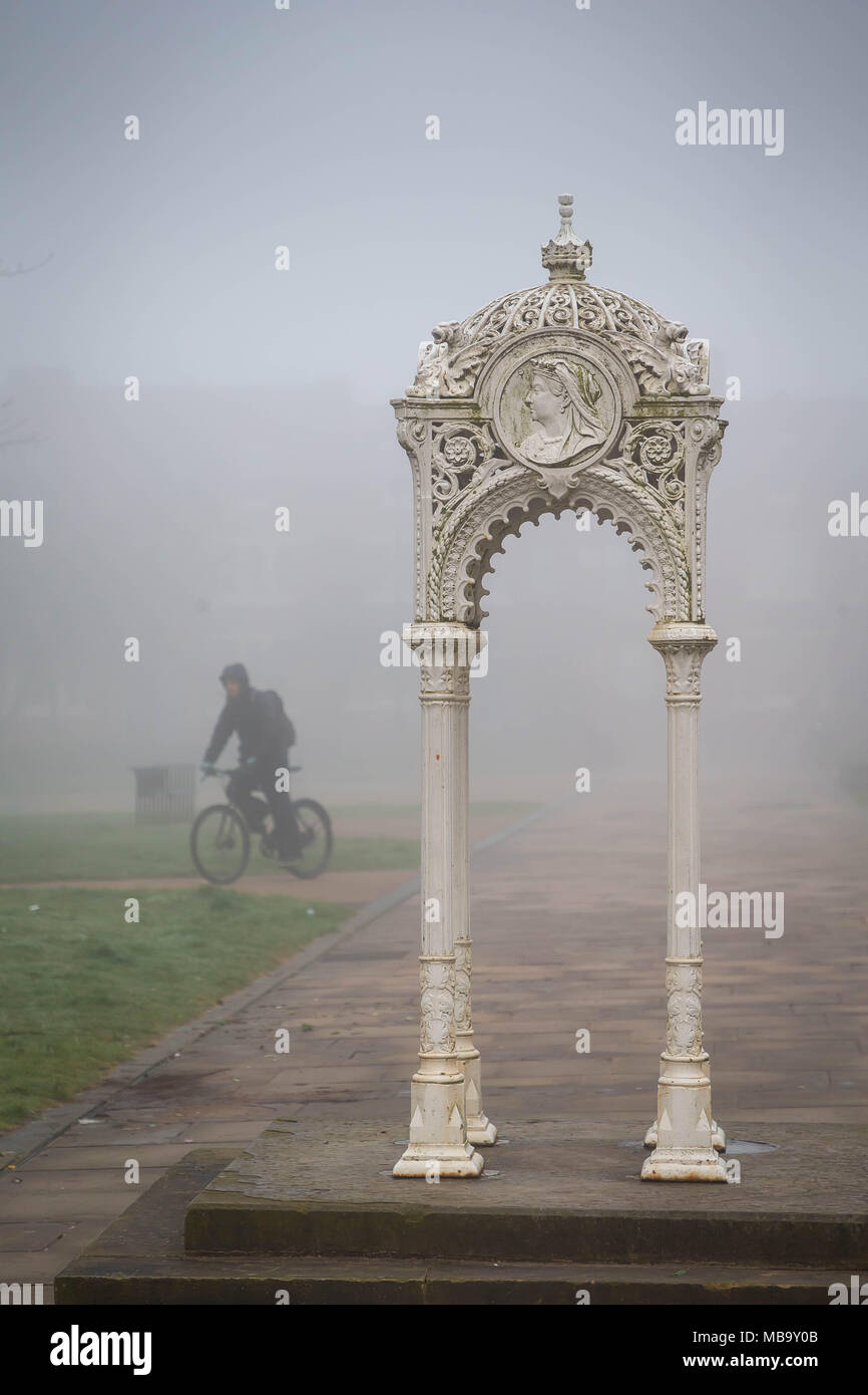 Warrington, Cheshire, UK. 9th April, 2018. On a foggy Monday morning, 9th April 2018,  a cyclist rides through Queen's Gardens in Warrington, Cheshire, England, UK on his way to work Credit: John Hopkins/Alamy Live News Stock Photo