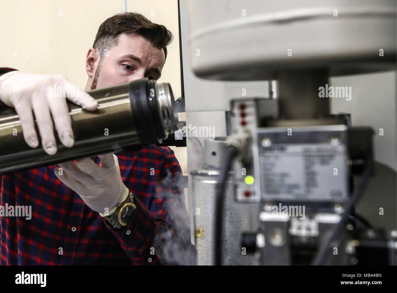 Moscow, Russia. 06th Apr, 2018. MOSCOW, RUSSIA - APRIL 6, 2018: An employee fills a Titan transmission electron microscope with liquid nitrogen at an electron microscopy laboratory of the Kurchatov Institute National Research Center. Valery Sharifulin/TASS Credit: ITAR-TASS News Agency/Alamy Live News - Stock Image