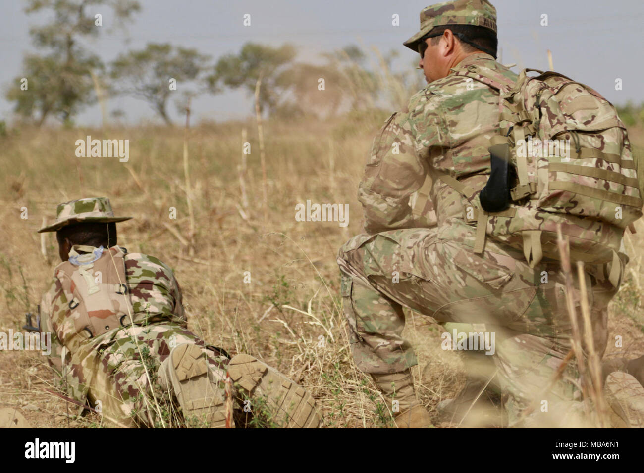 Twelve U S  Army Soldiers share tactics and training with a
