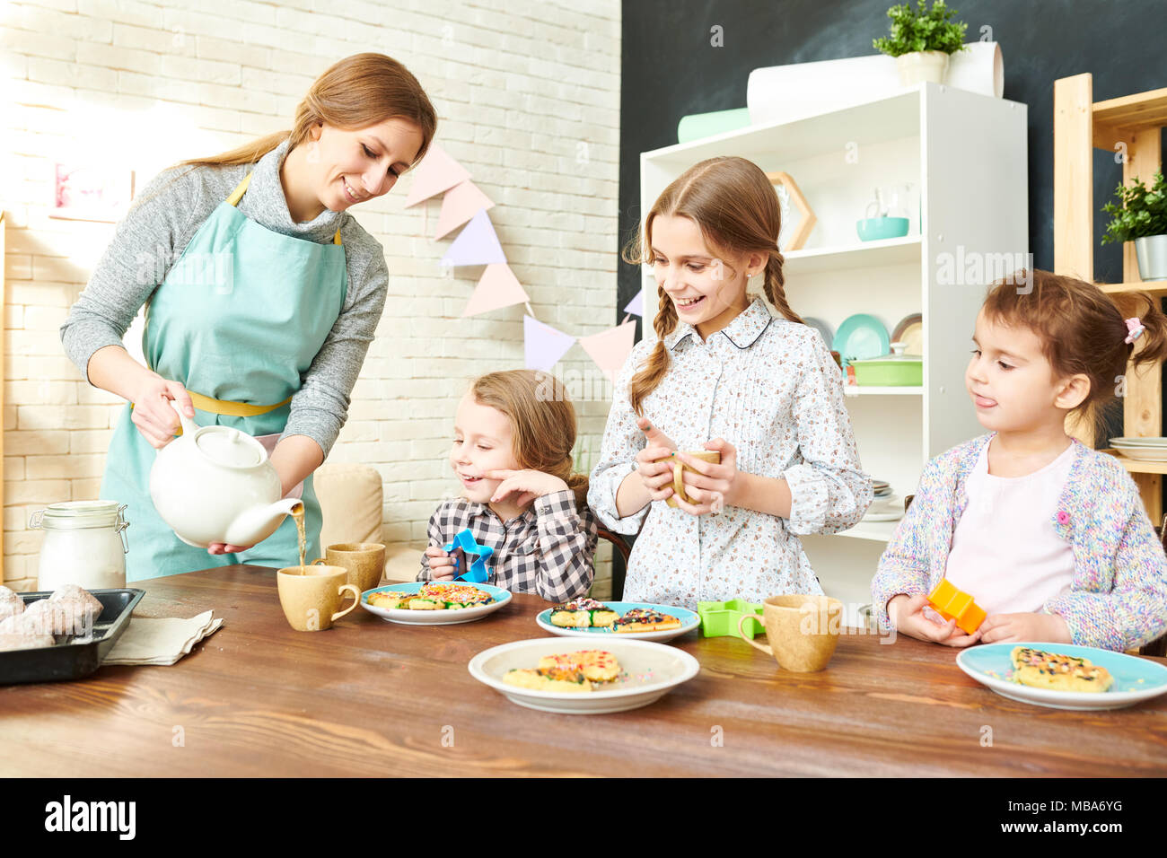 Adorable Family Having Tea Party - Stock Image