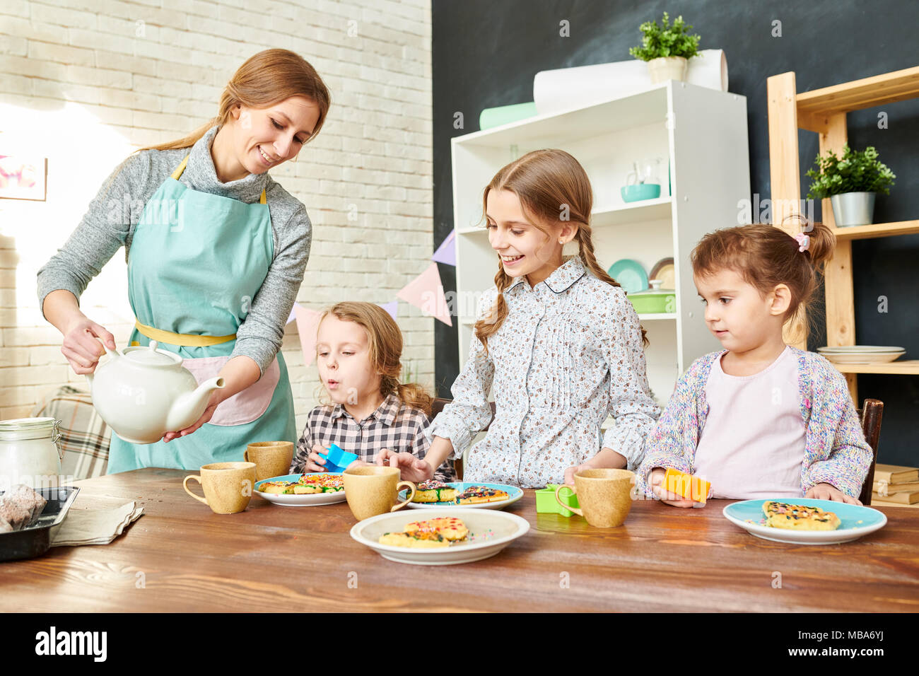 Loving Family Having Tea Party - Stock Image