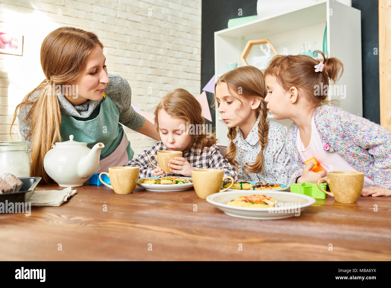 Loving Family at Dining Room - Stock Image