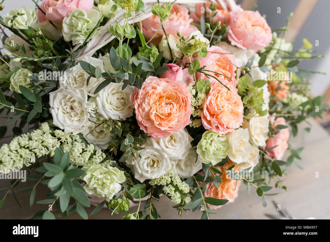 Beautiful flower composition a bouquet in a wicker basket floristry beautiful flower composition a bouquet in a wicker basket floristry concept spring colors izmirmasajfo