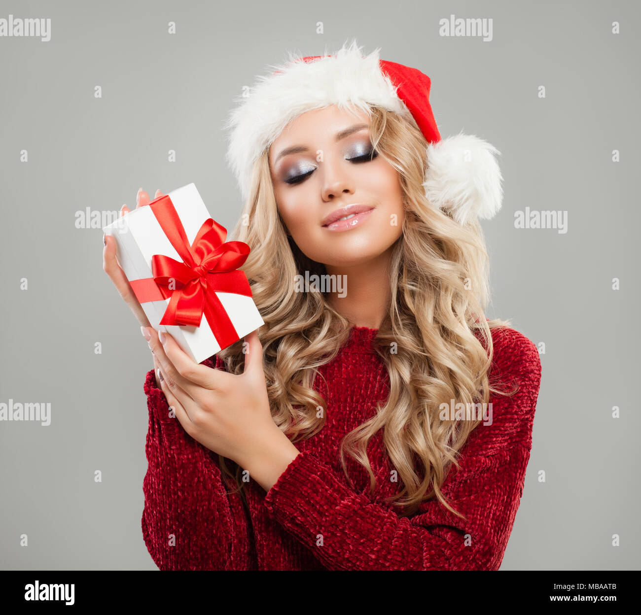 pretty christmas girl with christmas gift perfect woman in santa hat