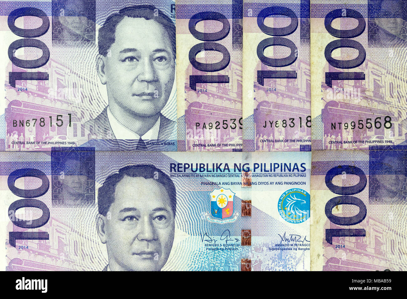 Currency banknotes spread across frame philippines peso in various denomination - Stock Image