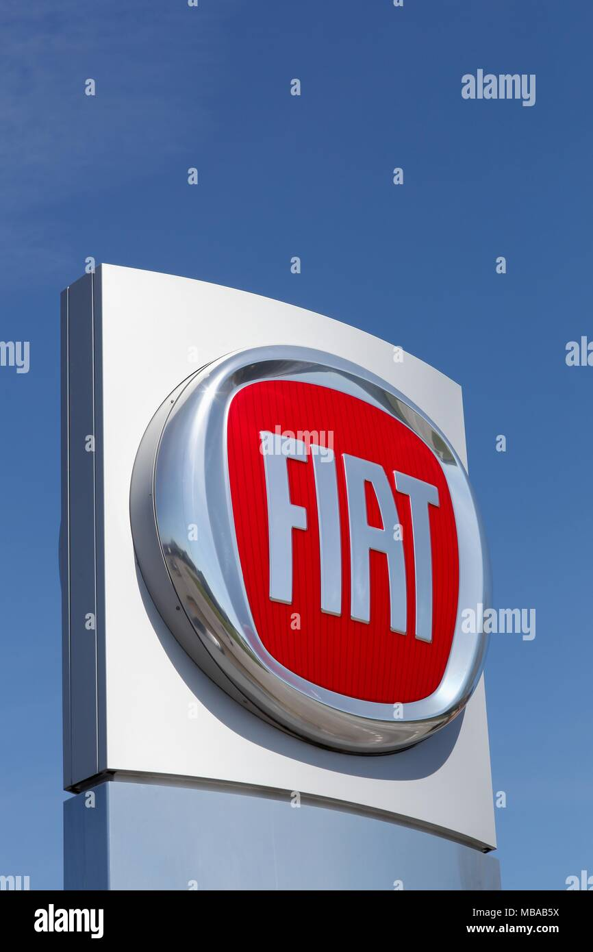 Ebeltoft, Denmark - May 5, 2016: Fiat logo on a panel. Fiat Chrysler Automobiles is an Italian-American corporation Stock Photo
