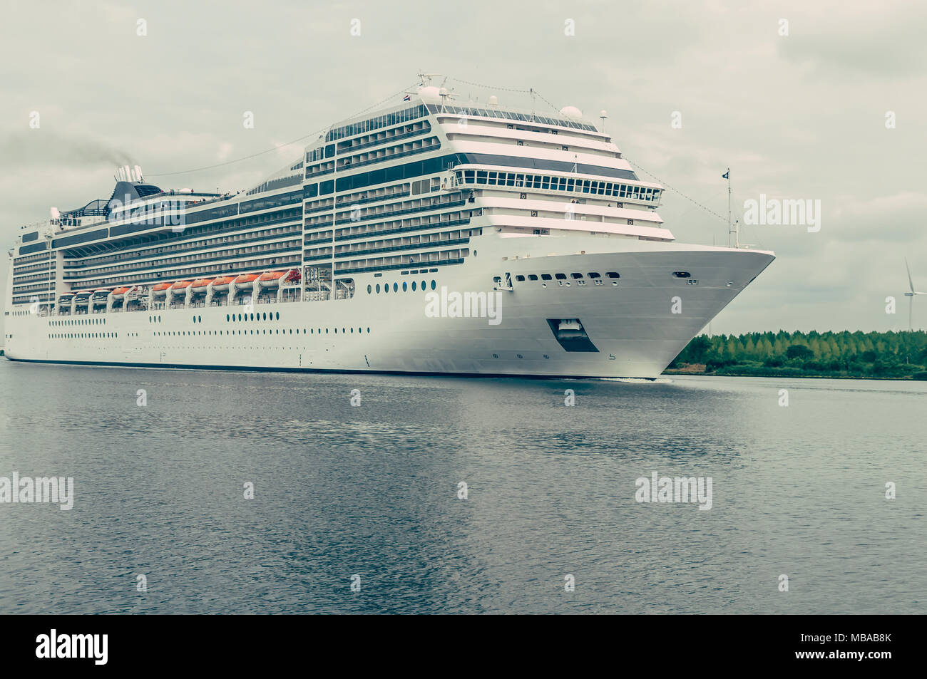 a large cruise ship sails through the canal - Stock Image