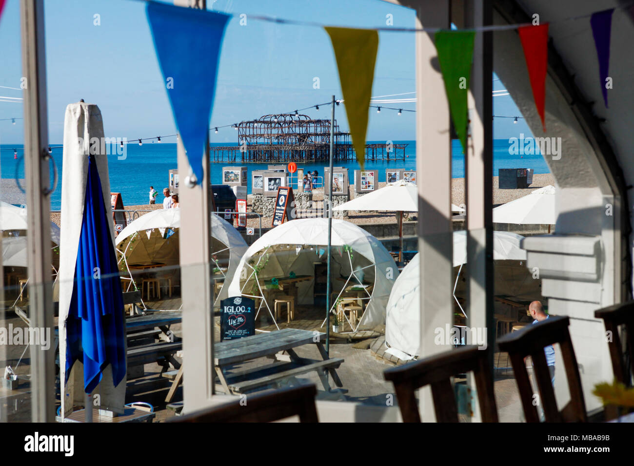 Brighton Music Hall overlooks the East Pier on a clear summer's day with drinking pods in their outdoor space for reservation. September 2017. Stock Photo