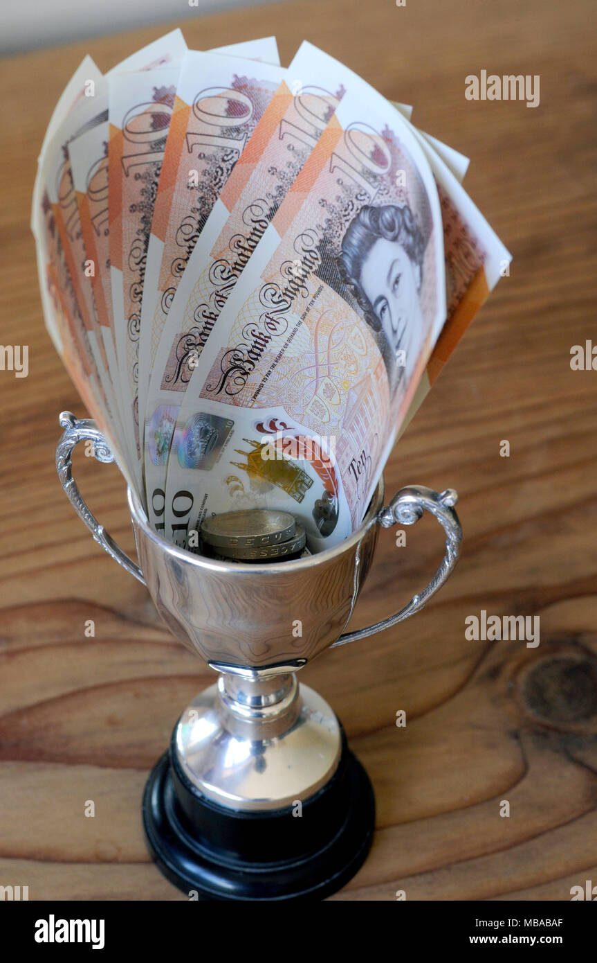 Small winners trophy with a cash prize of ten pound notes in the cup. 2018 Stock Photo