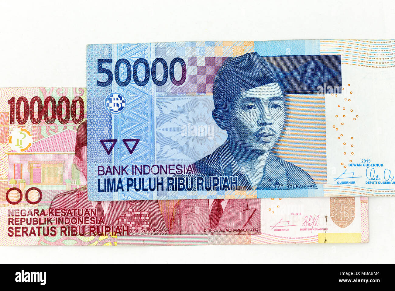 Currency banknotes spread across frame indonesian rupiah in various denomination - Stock Image
