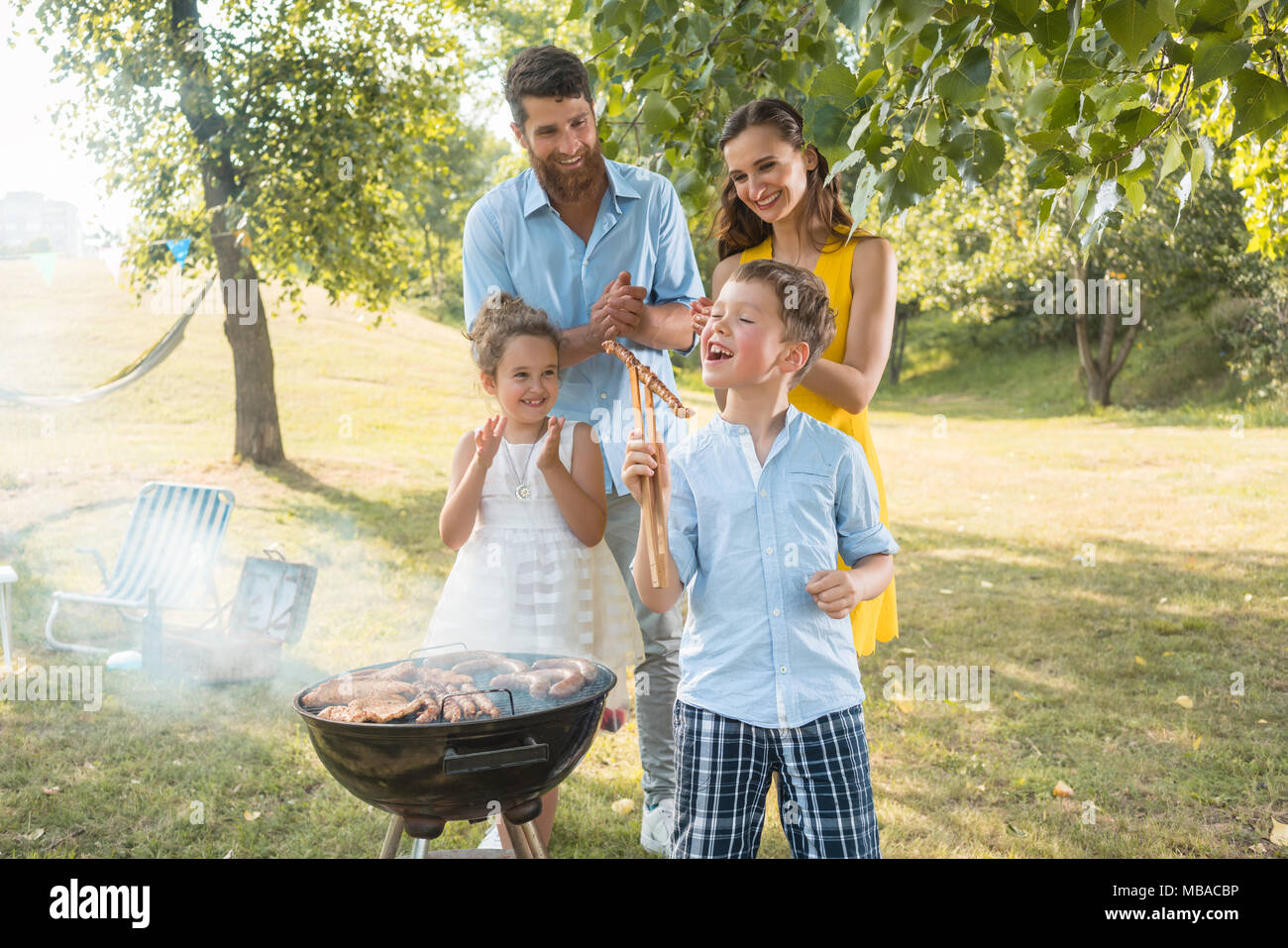 Portrait of happy family with two children outdoors - Stock Image