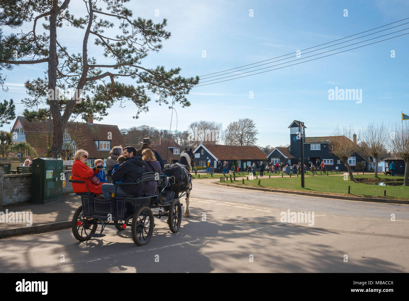 Thorpeness Suffolk, visitors to Thorpeness in Suffolk enjoy a pony and trap ride around the centre of the village, England, UK. - Stock Image
