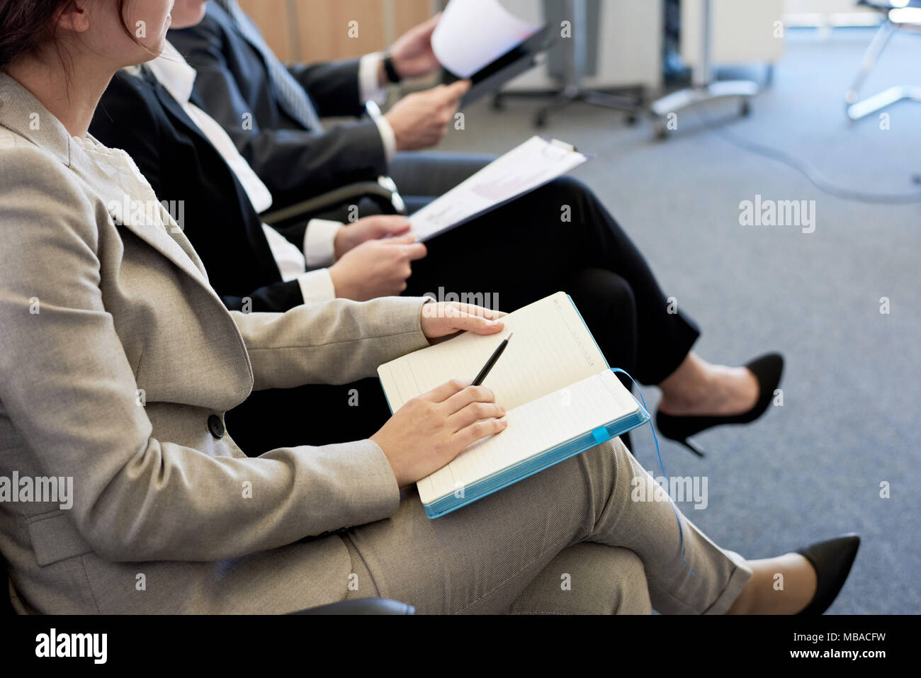 Business People in Audience - Stock Image