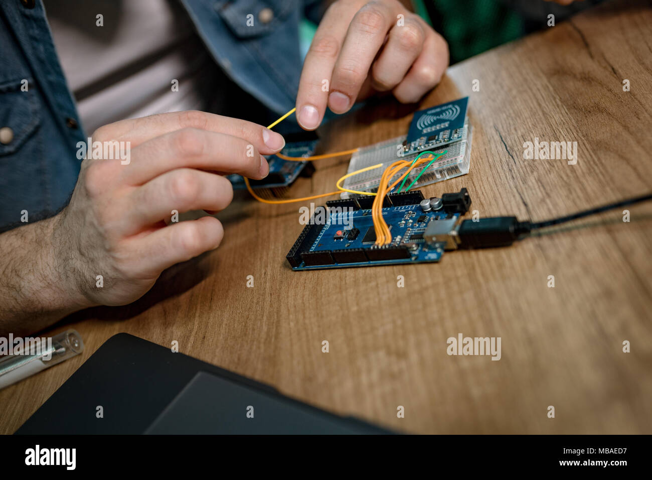 Close Up Of A Male Hands Soldering Circuit Board On The Table Stock