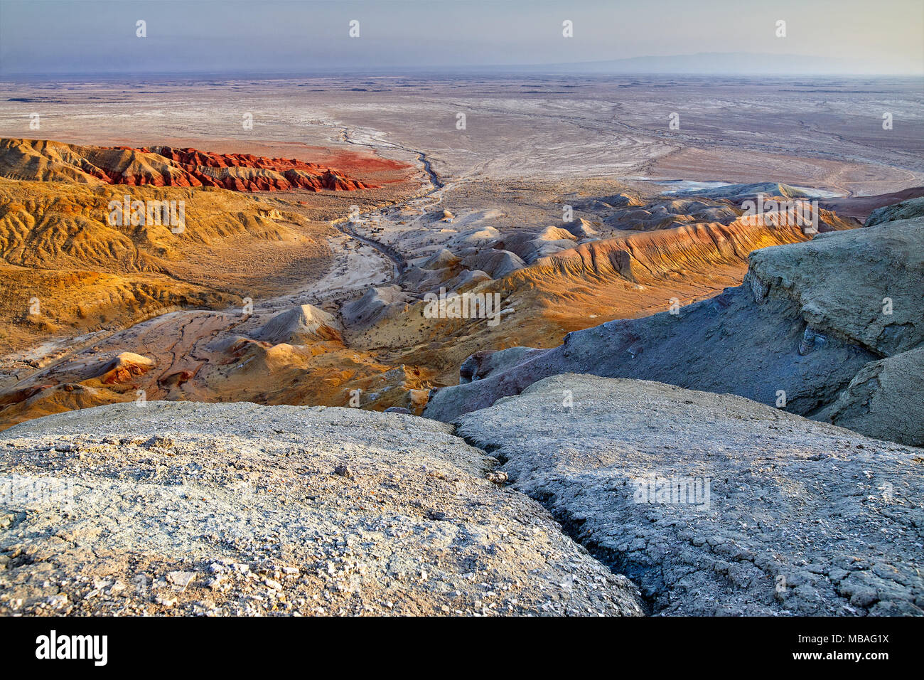 Aerial view of bizarre layered mountains in desert park Altyn Emel in Kazakhstan - Stock Image