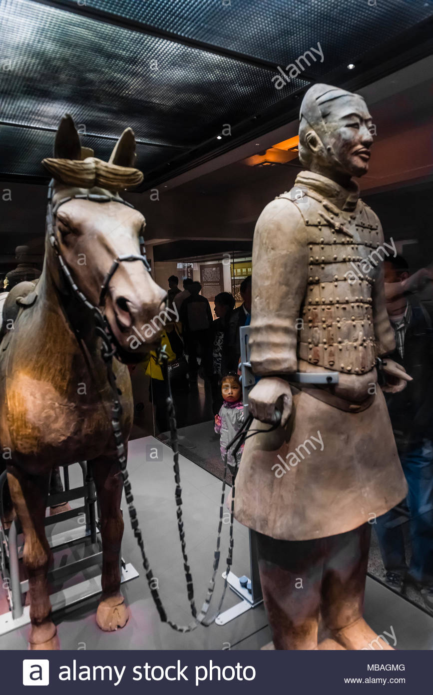 A Cavalryman and his saddled War-horse of the Terracotta Army. 116 similar cavalrymen with their horses were found in Pit 2. Mausoleum of the FIrst Qi - Stock Image