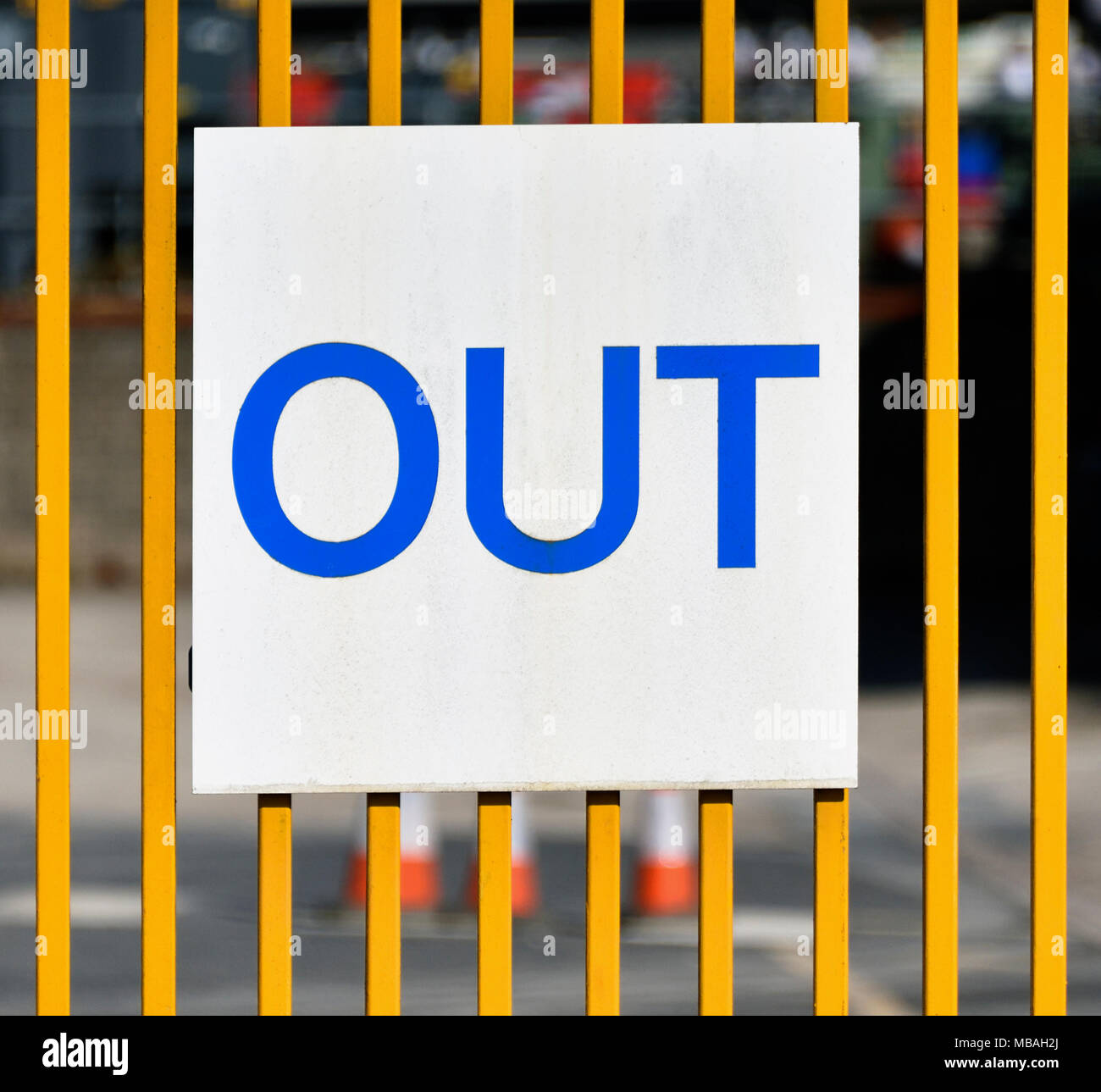 'OUT' sign on metal gate to industrial site. Parkside Road, Kendal, Cumbria, England, United Kingdom, Europe. - Stock Image
