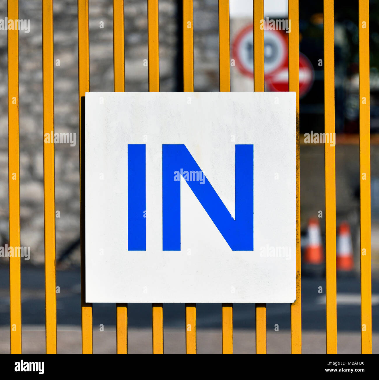 'IN' sign on metal gate to industrial site. Parkside Road, Kendal, Cumbria, England, United Kingdom, Europe. - Stock Image