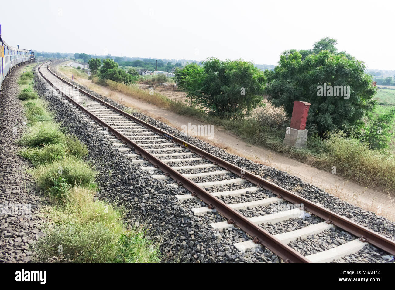 running train side view with railway track looking awesome. Stock Photo