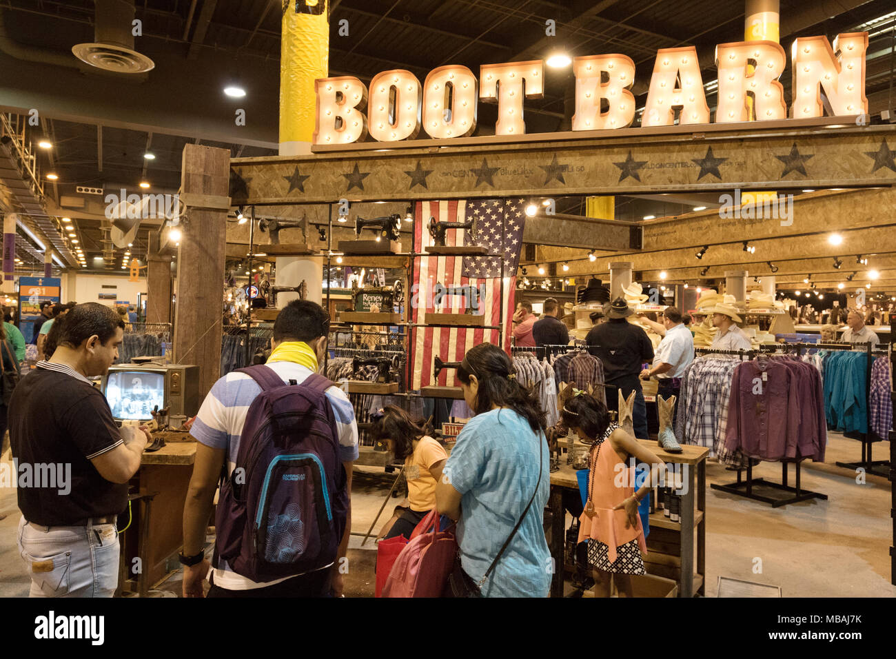 a texas family buying boots at boot barn store houston livestock
