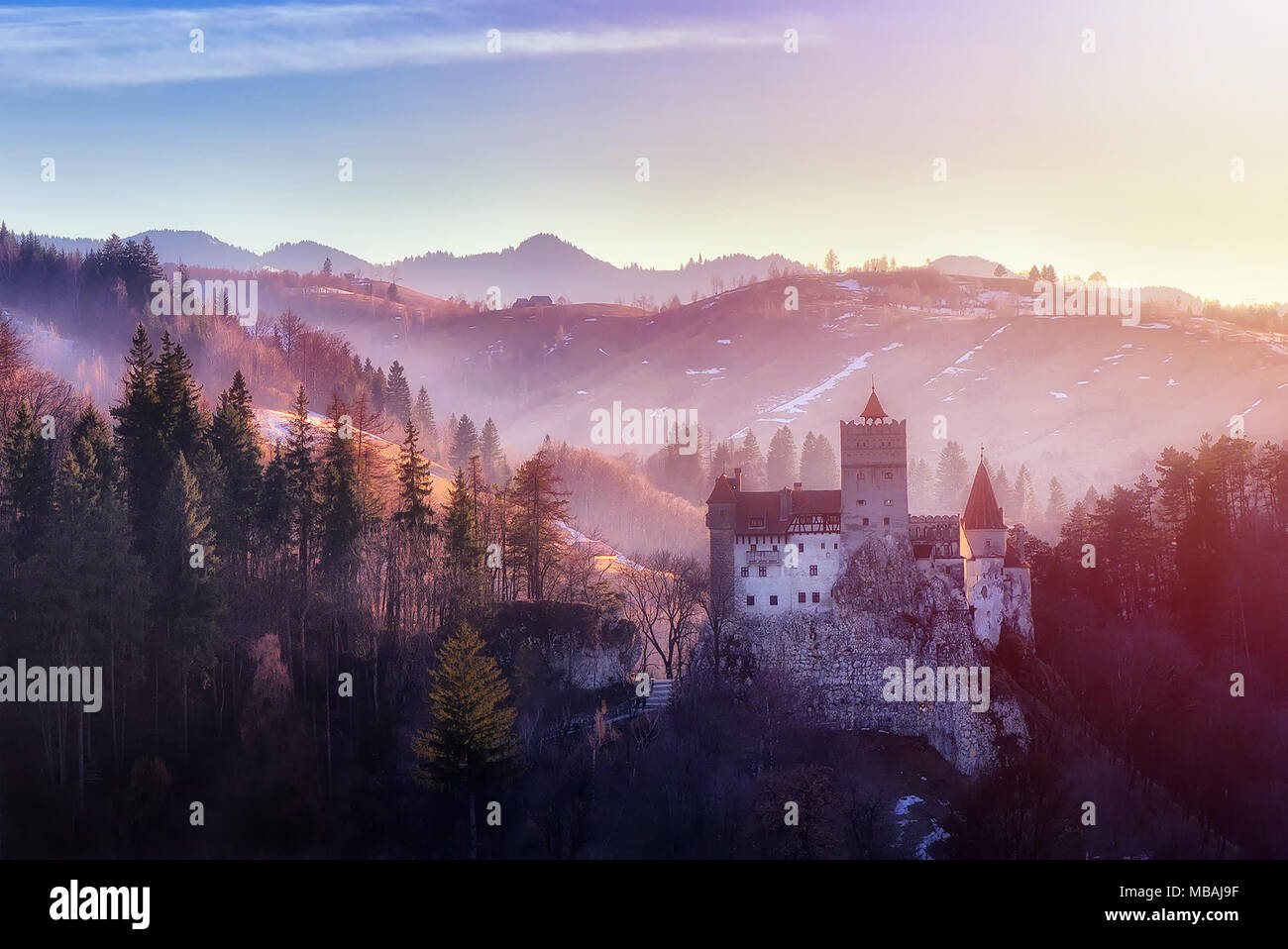 Bran or Dracula Castle in Transylvania, Romania. The castle is located on top of a mountain, sunset light - Stock Image