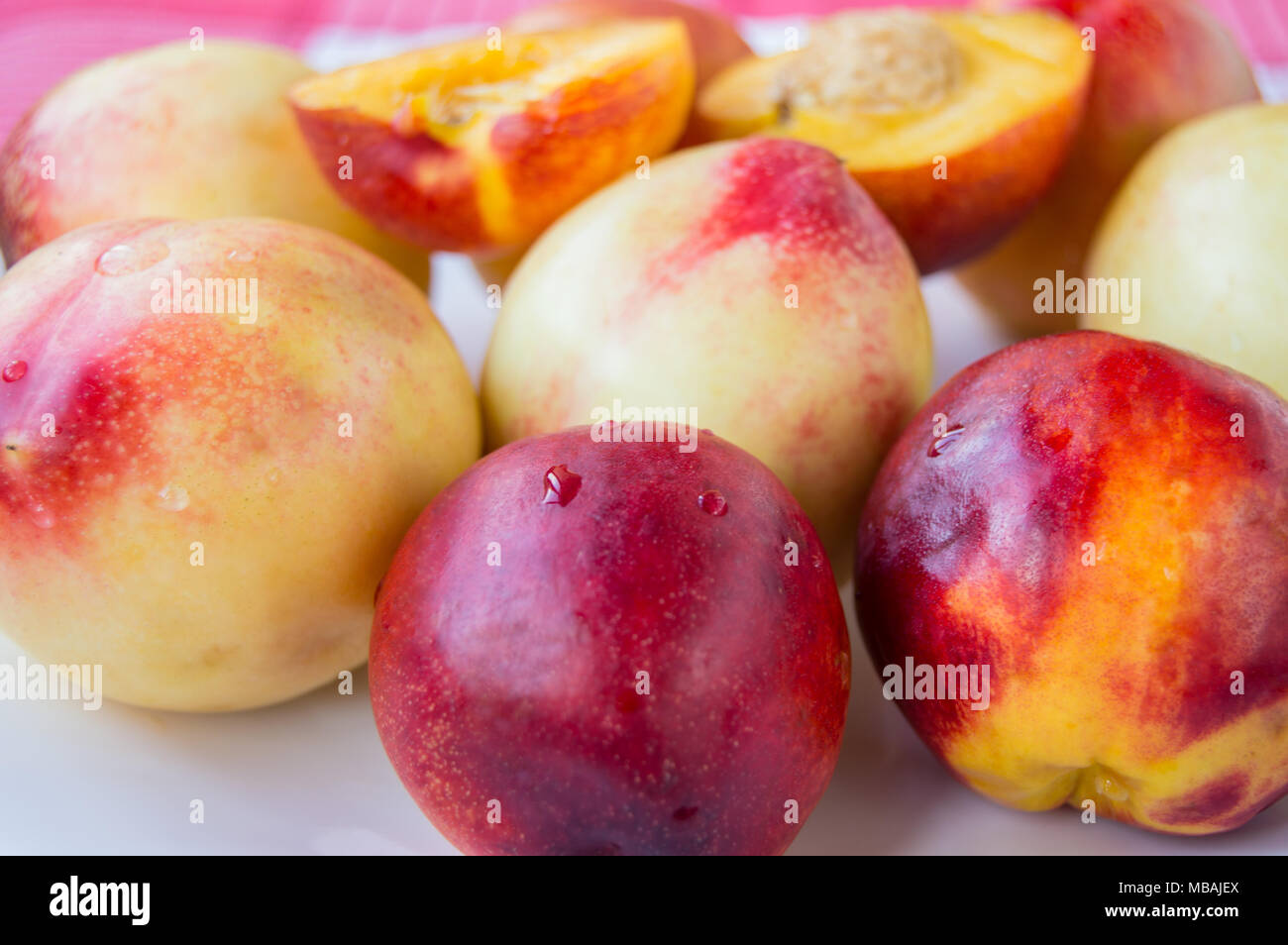 red ripe nectarine peaches with sliced selective focus - Stock Image
