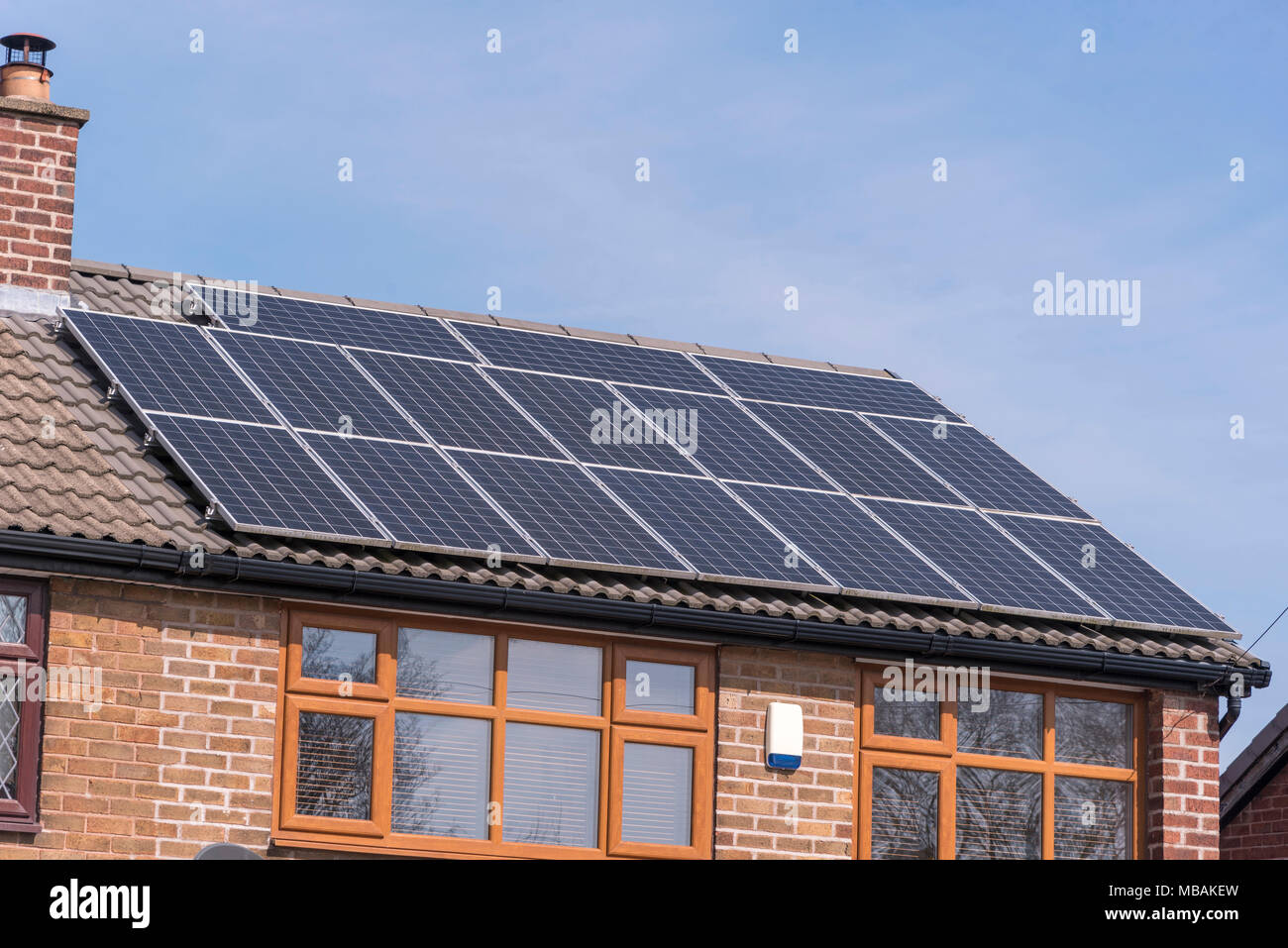 Solar roof panels on house. - Stock Image