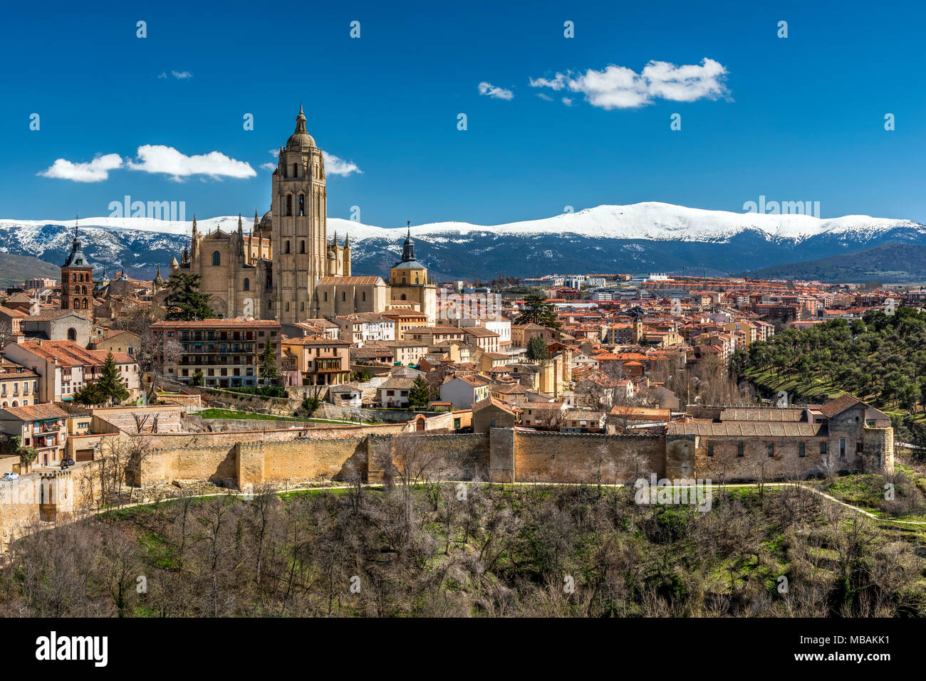 City skyline with the Gothic Cathedral and the snowy mountains of Sierra de Guadarrama in the background, Segovia, Castile and Leon, Spain Stock Photo