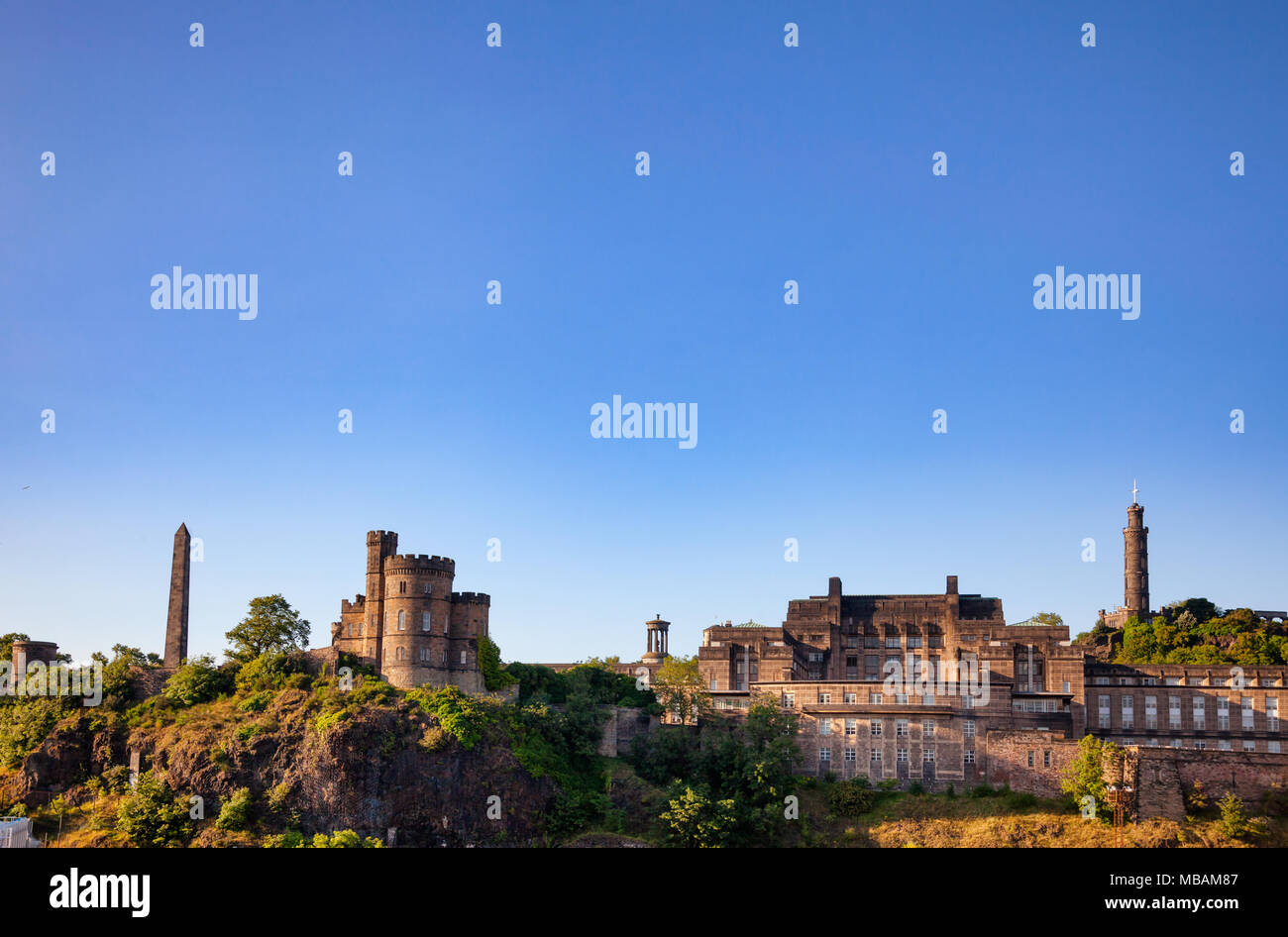Calton Hill view with Political Martyrs Monument, Governors House, Robert Burns Monument, St. Andrews House and Nelsons Monument, Edinburgh, Scotland, Stock Photo