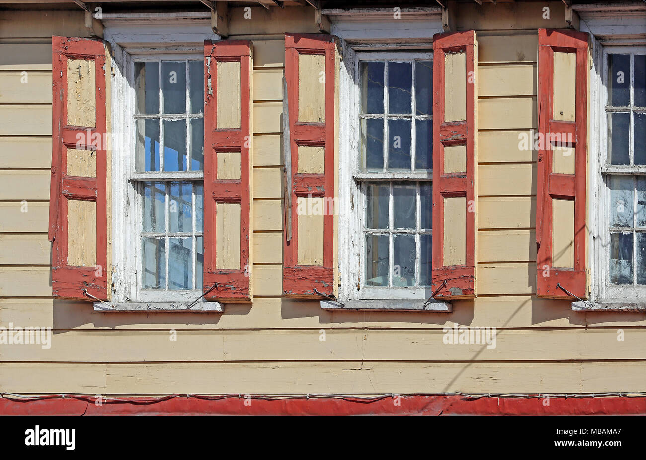 Rustic Building Detail With Tan Wooden Siding And Windows